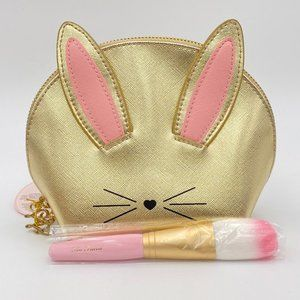 Brand new Too Faced makeup bag and brush.